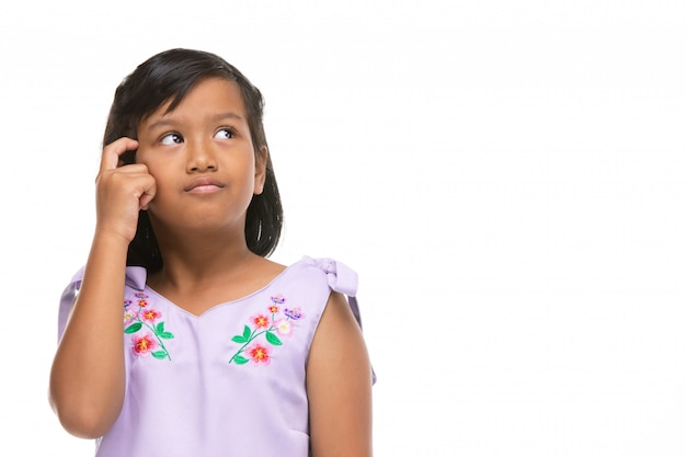 Cute asian dark little girl thinking emotion on face .