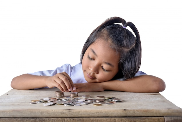 Cute asian girl counting and pile coins for saving isolated on white background