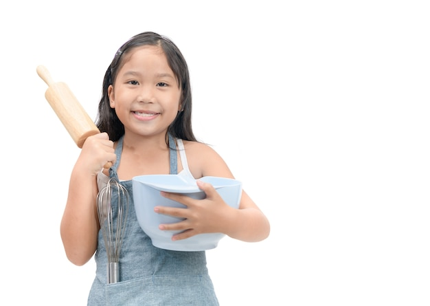 Cute asian girl holding cooking utensils isolated