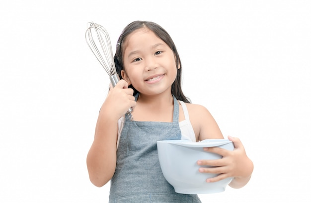 Cute asian girl holding cooking utensils