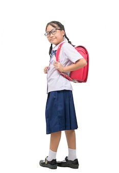 Cute asian girl student wears uniform and carries school bag isolated