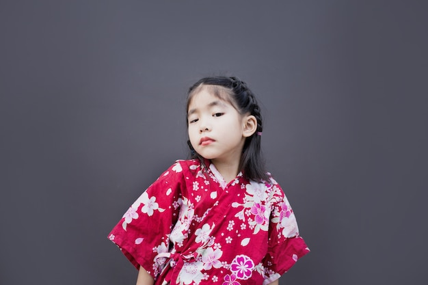Cute asian kid with japanese style dress