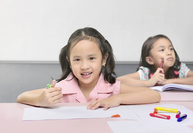 Cute asian kids learning