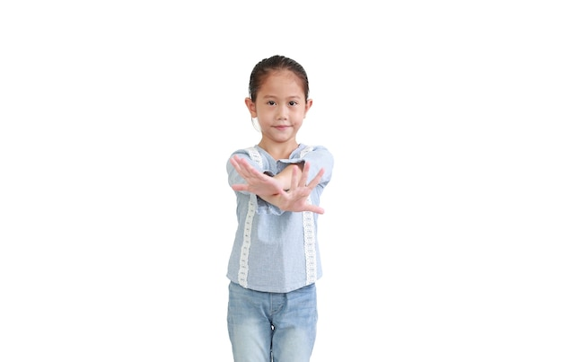 Cute asian little child girl reaching cross arm hands break in front of isolated on white background.