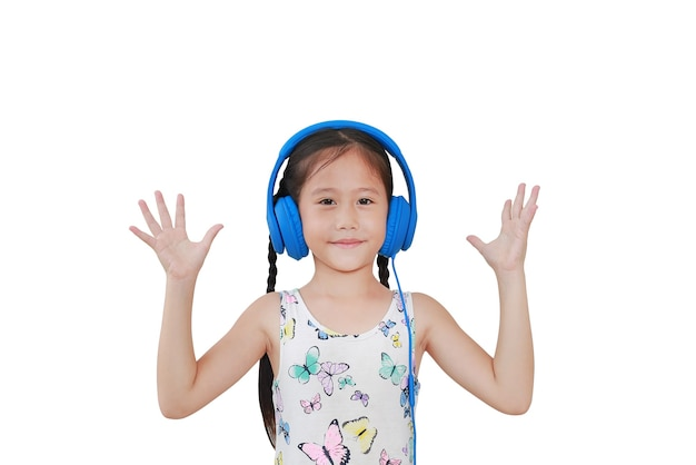 Cute asian little kid girl with blue headphones and open hands isolated on white background