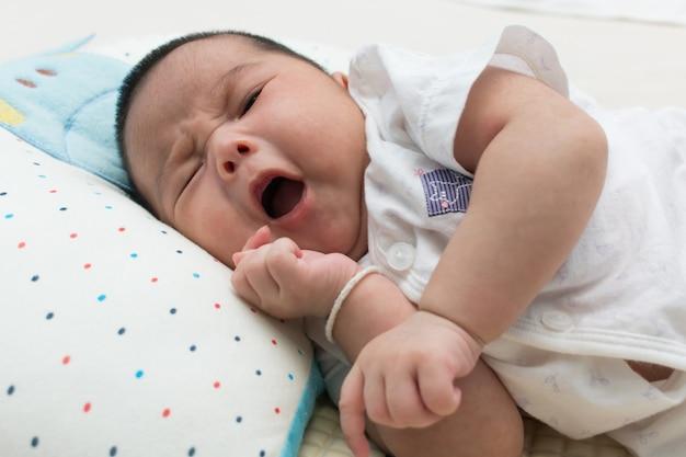 Cute asian newborn yawning