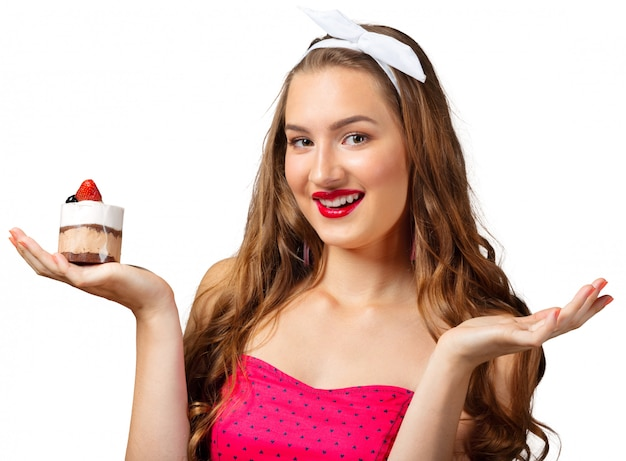 Cute attractive young woman standing and holding cup dessert