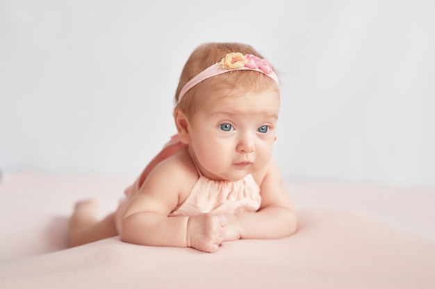 Cute baby 3 months on a light