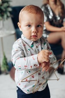 Cute baby boy with decorative star.