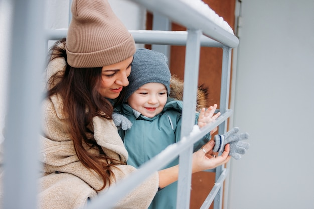 Cute baby boy with mother explore world in winter season