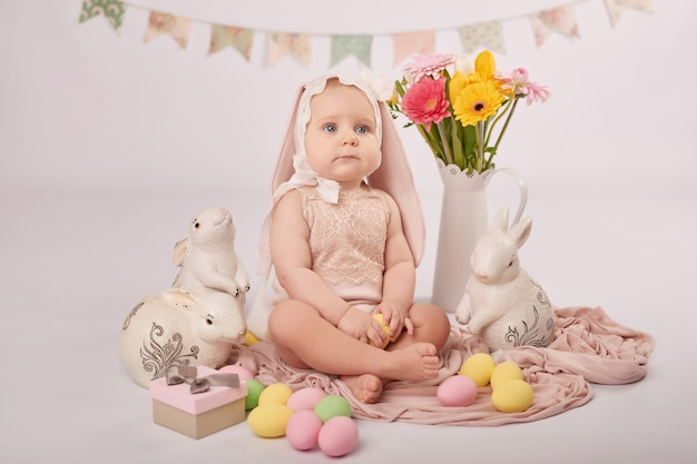 Cute baby in easter composition