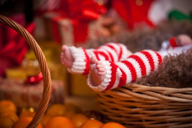 Cute baby feet closeup of christmas. selective focus.