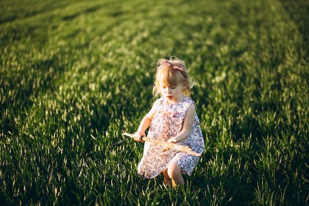 Cute baby girl in field