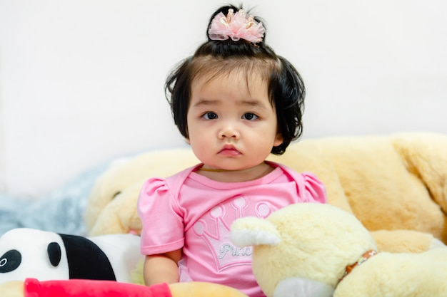 Cute baby girl in a pink dress