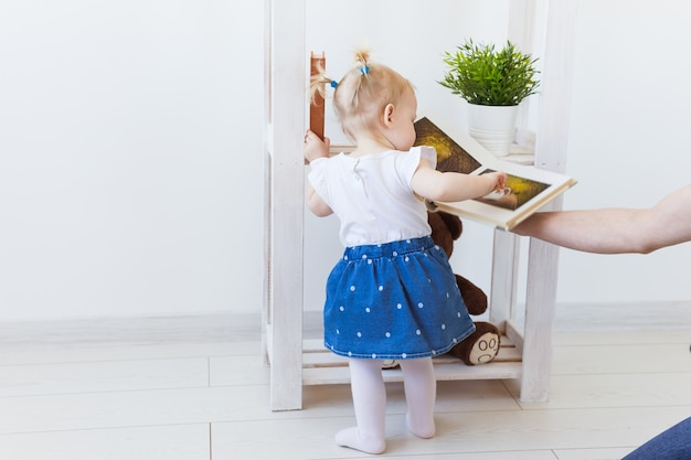 Cute baby girl playing indoors. childhood, infant and children concept. close-up.