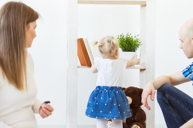 Cute baby girl playing indoors. childhood, infant and children concept.