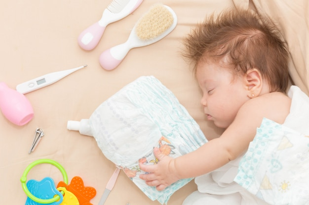 Cute baby girl sleeping safely.