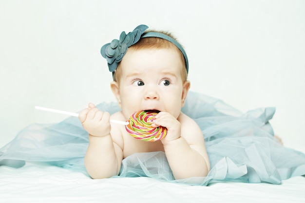Cute baby girl with a lollipop
