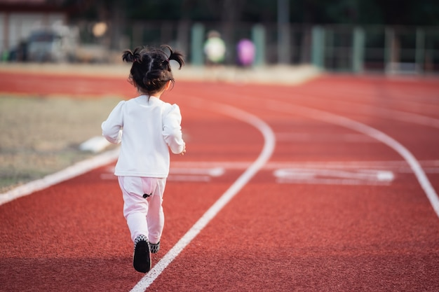 Cute baby running in the stadium