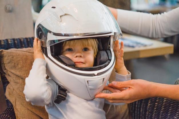 Cute baby wearing a motorbike helmet