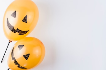 Cute balloons decorated as pumpkins