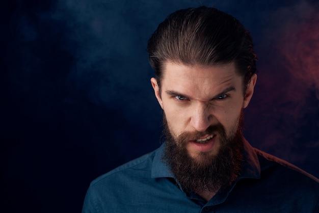 Cute bearded man in shirt elegant style close-up dark background.