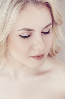 Cute beautiful blonde woman portrait, eyes closed