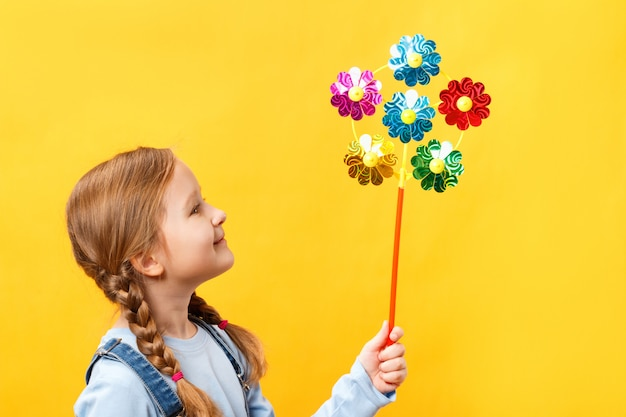 Cute beautiful child holding a pinwheel toy