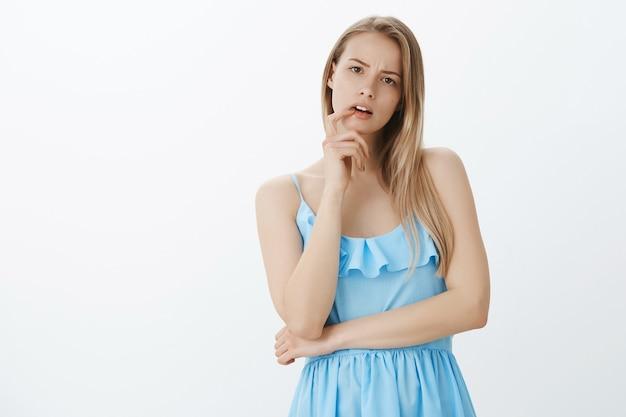 Cute blonde girl in stylish blue dress