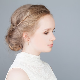Cute blonde girl with prom hairstyle profile