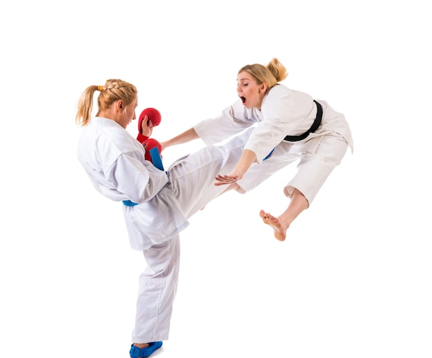 Cute blonde girls karate are engaged in training in a kimono