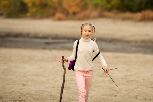 Cute blonde little girl with two braids