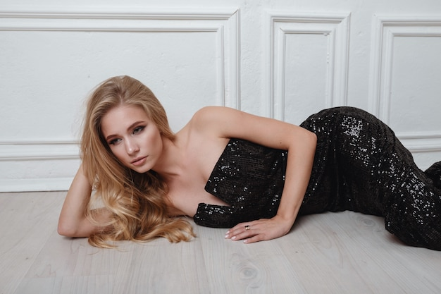 Cute blonde woman in gorgeous black dress