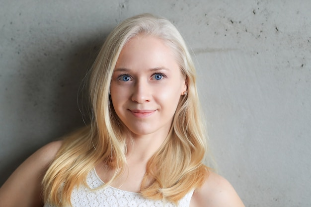 Cute blonde woman in white fashion dress