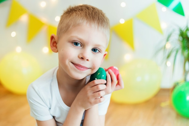 Cute boy 5 years old with easter eggs