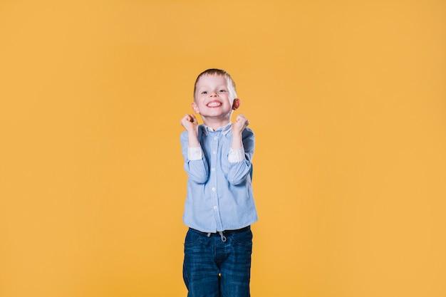 Cute boy celebrating success