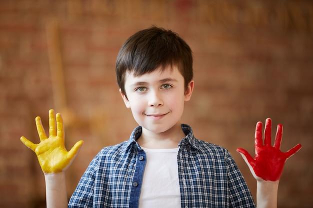 Cute boy fingerpainting