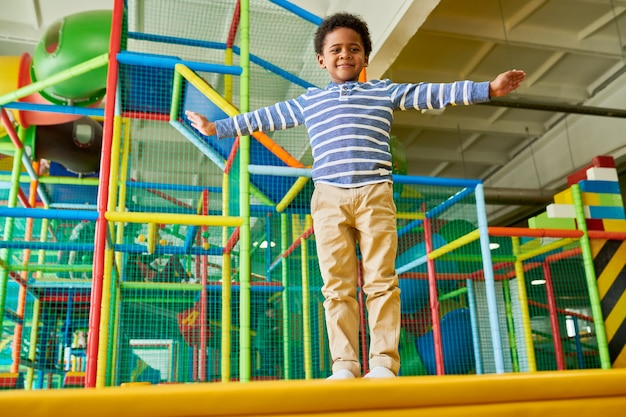Cute boy posing in play area