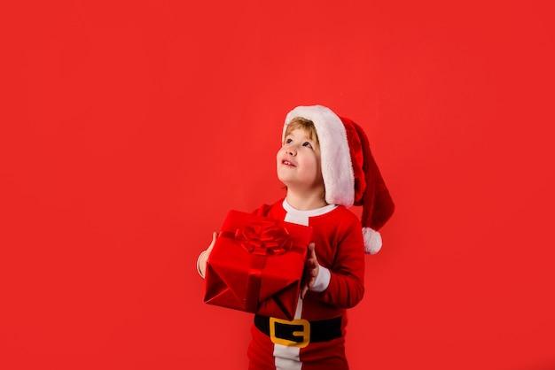 Cute boy in santa hat christmas children little kids celebrating christmas child with christmas