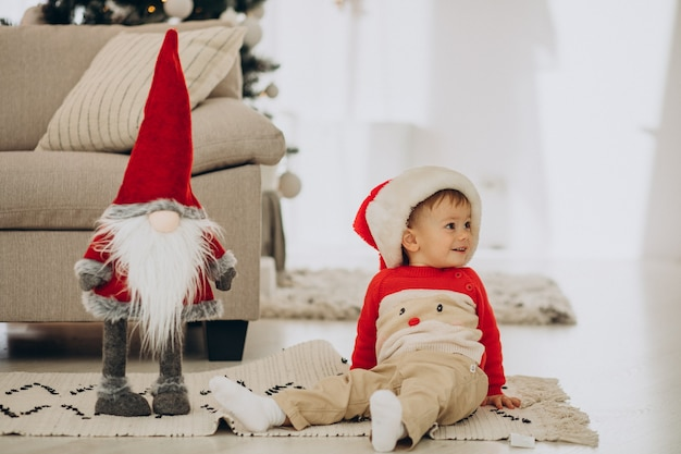 Cute boy wearing santa hat on christmas