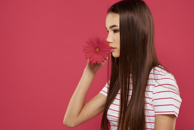 Cute brunette striped t shirts red flower romance fashion pink background