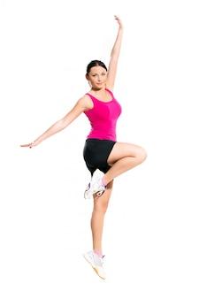 Cute brunette woman jumping