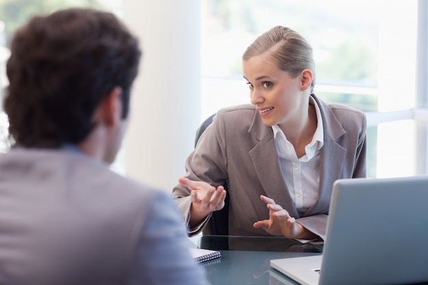 Cute businesswoman receiving a customer
