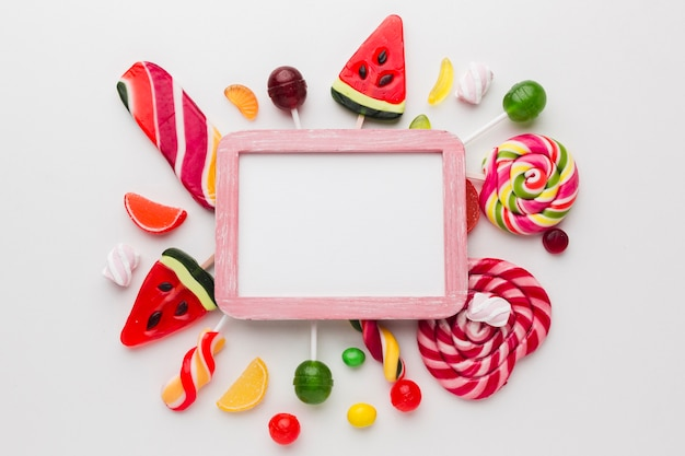 Cute candies frame with copy space