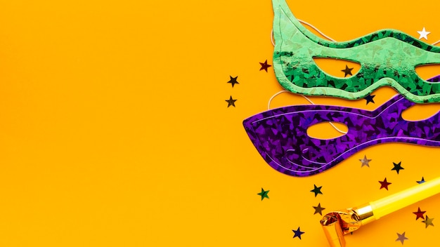 Cute carnival masks on yellow background