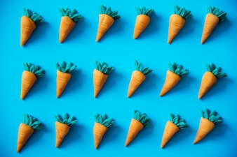 Cute carrots as a colorful pattern