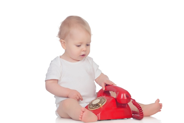 Cute caucasian baby playing with telephone