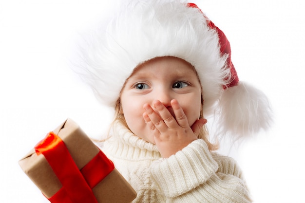 Cute caucasian kid hold christmas present box