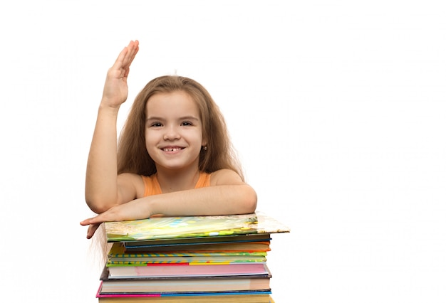 Cute caucasian little girl with books. school portrait. isolated on white background