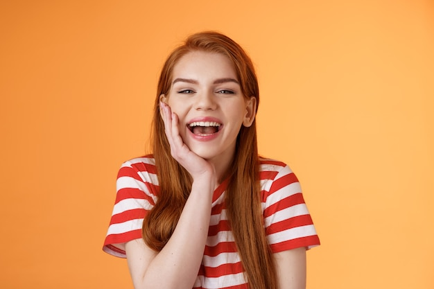 Cute cheerful smiling redhead woman talking friends laughing out loud happily showing healthy toothy...